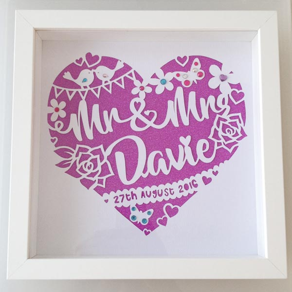 Hand cut wedding paper cut from abover