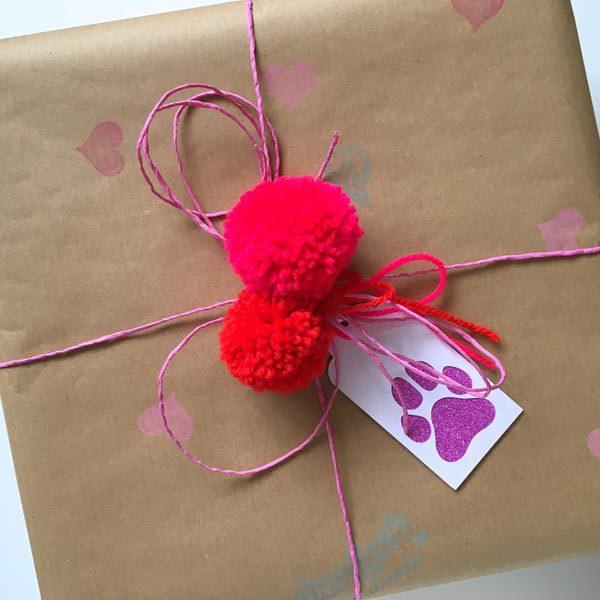 Pink dog tag on parcel