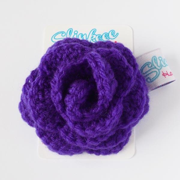 Purple rose brooch on card