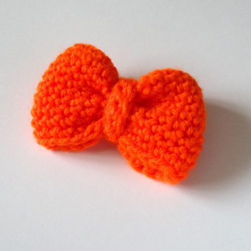 Orange bow brooch front